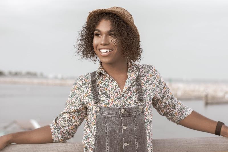 woman near lake smiling