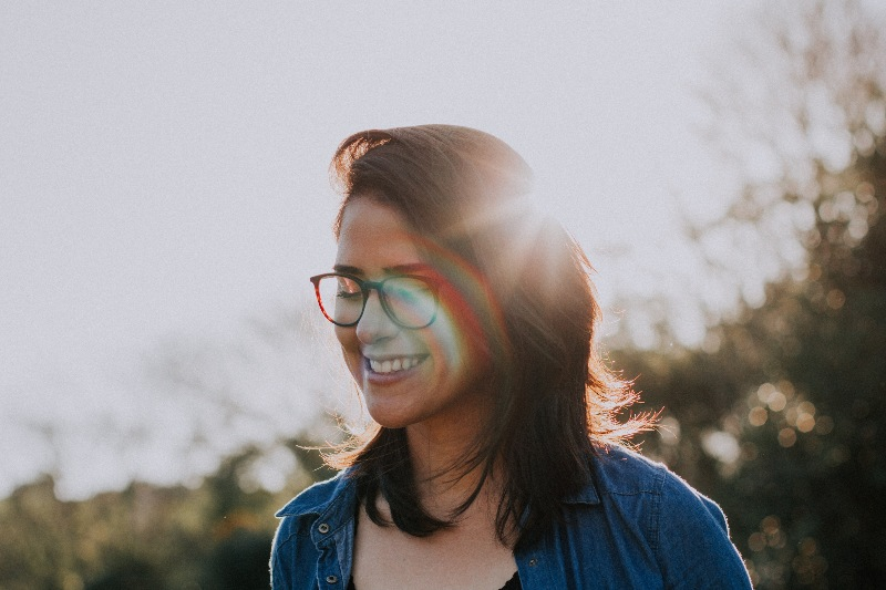 woman wearing glasses smiling