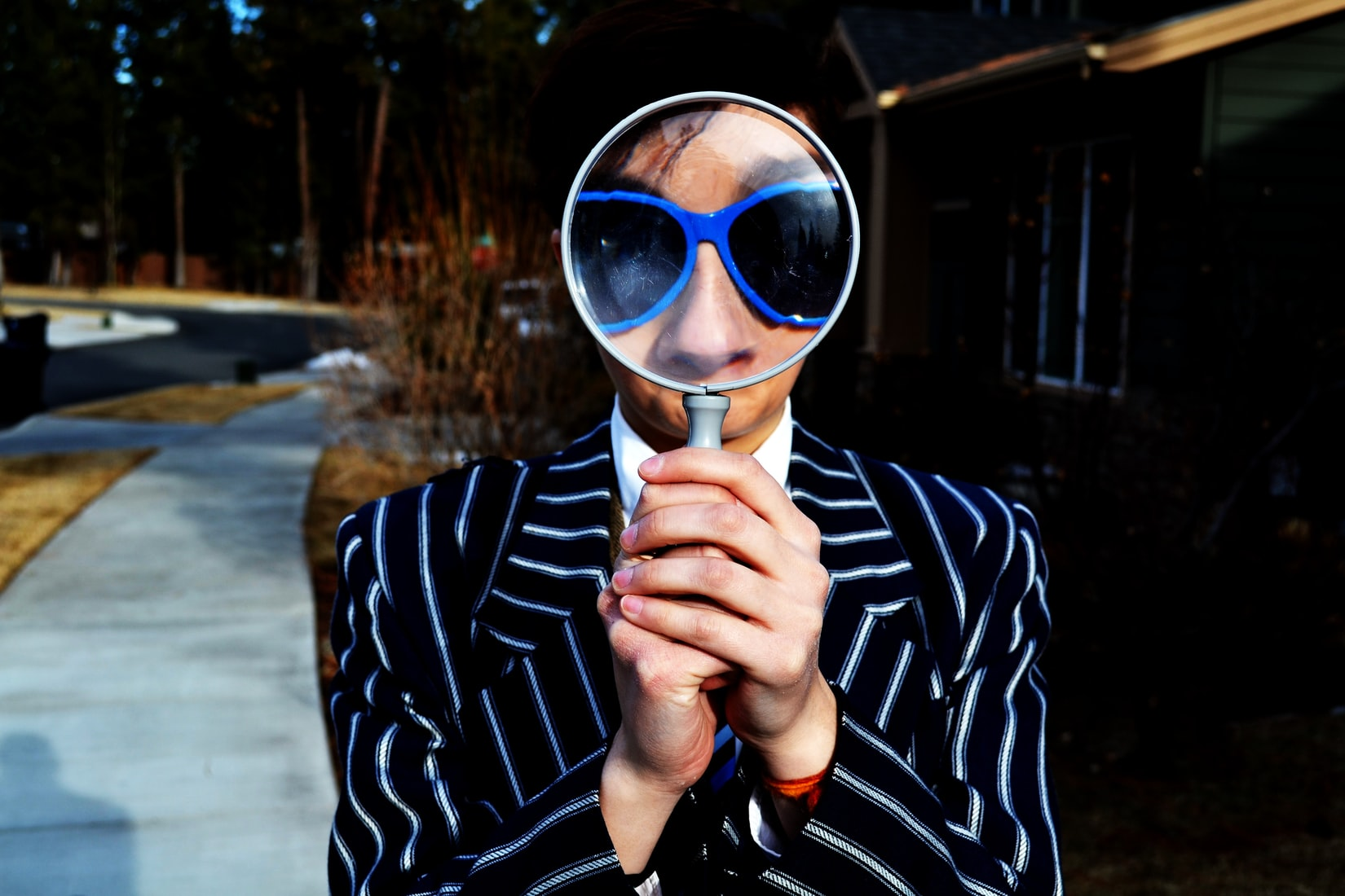 person holding a magnifying glass