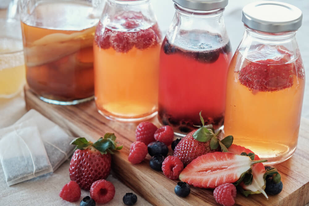 Jars of Kombucha with added fruit.