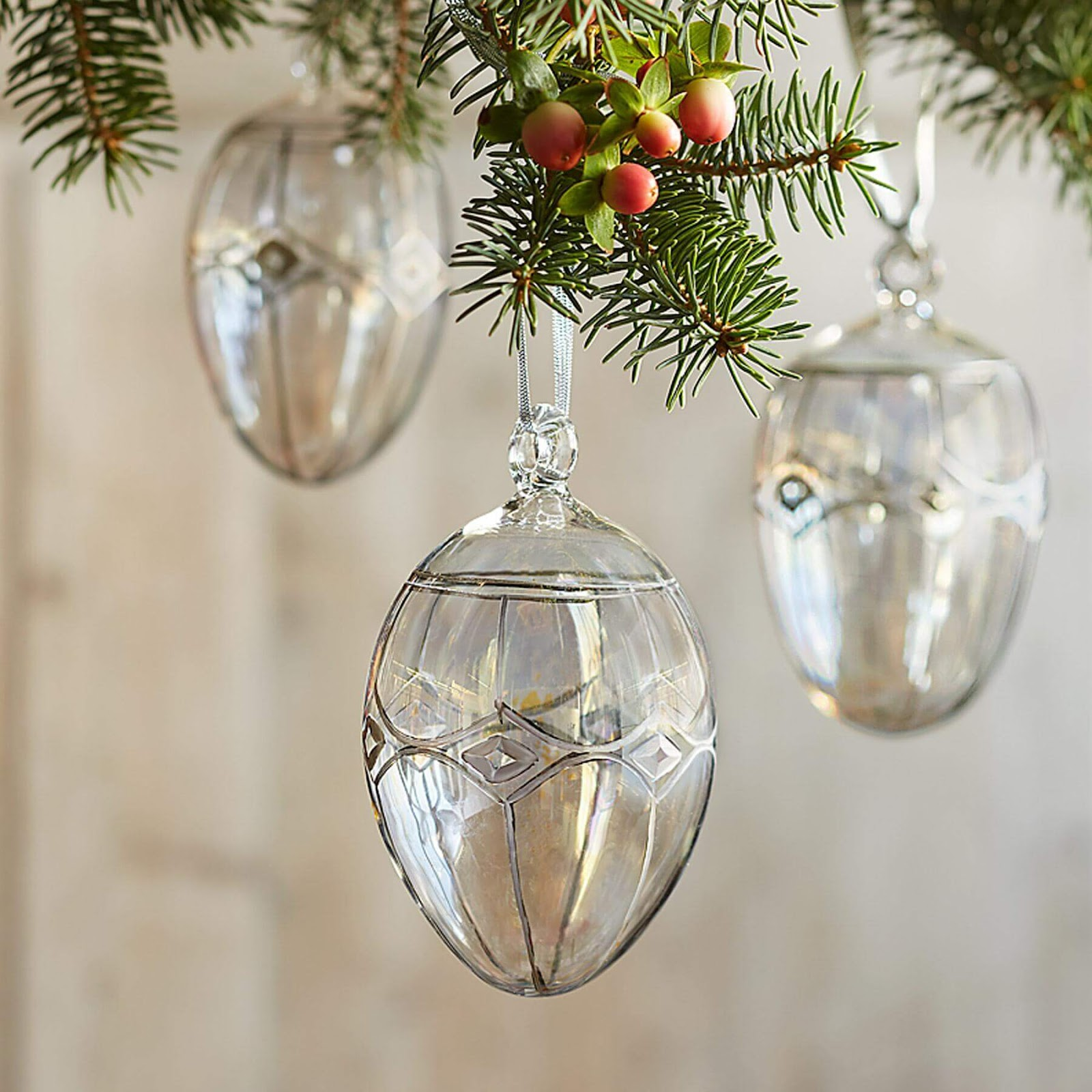 Brilliant Glass Egg Ornaments hanging from a tree.