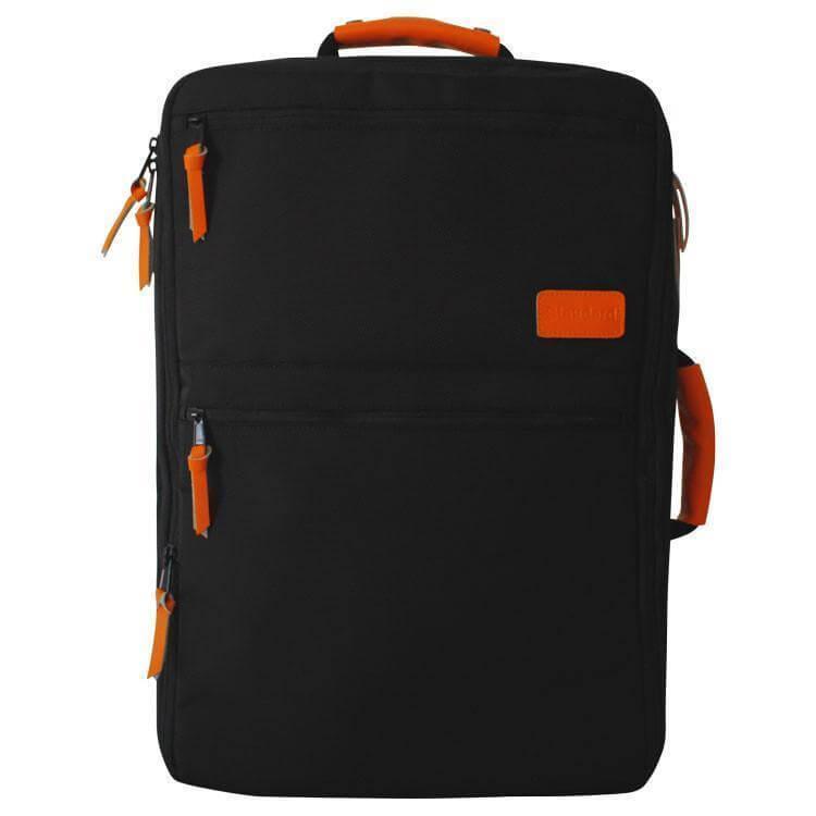 The orange and black Standard Luggage Co. travel bag.