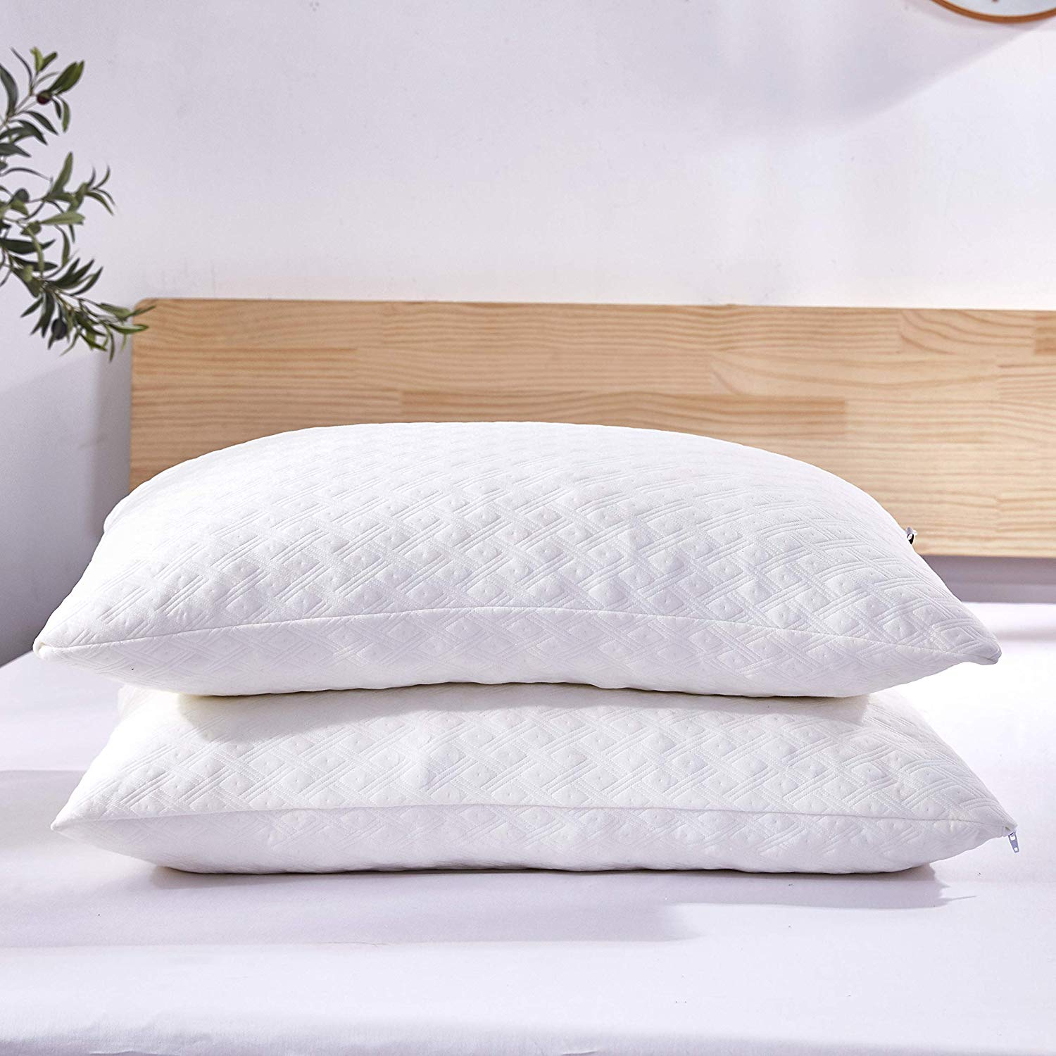 Two memory phone pillows on a bed.
