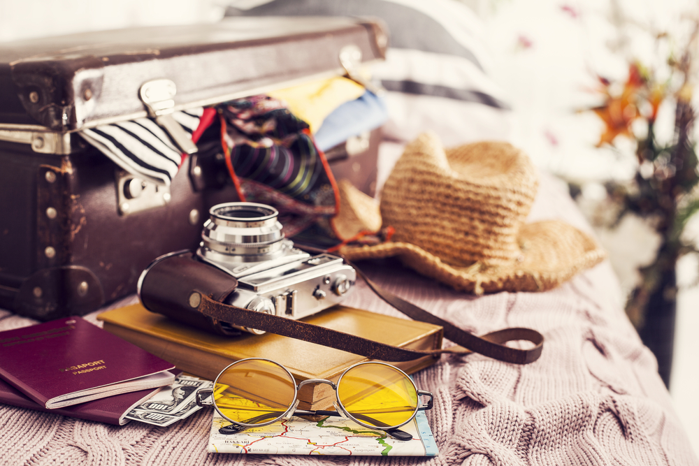 A camera, hat, and other travel gear.