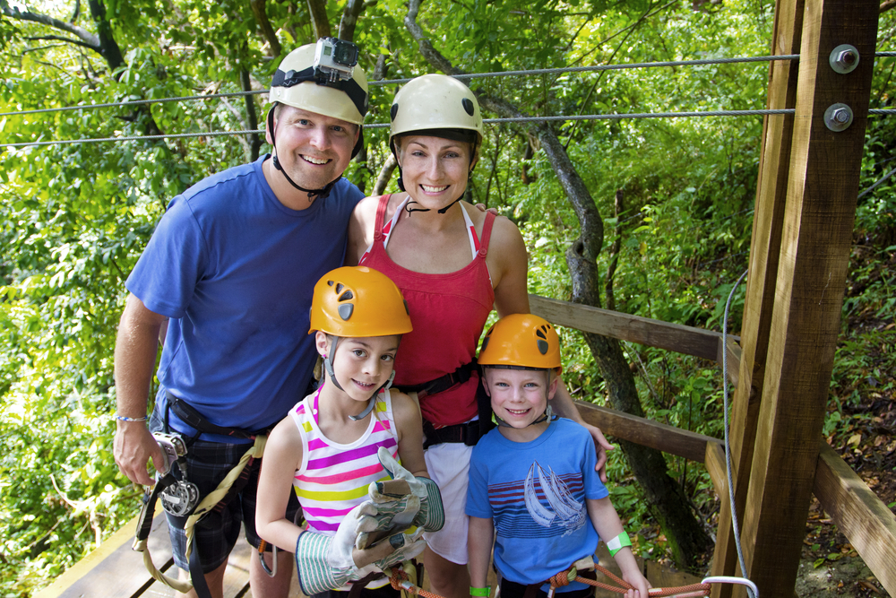 A family zip lining on a port day.