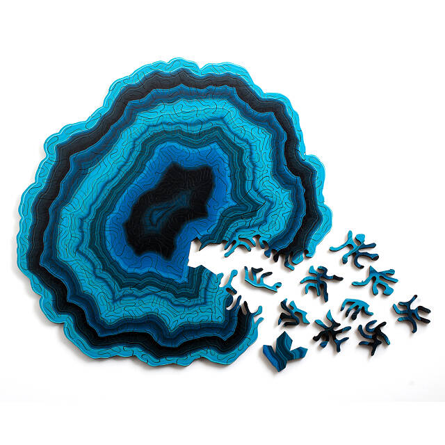 A puzzle that looks like a blue geode.