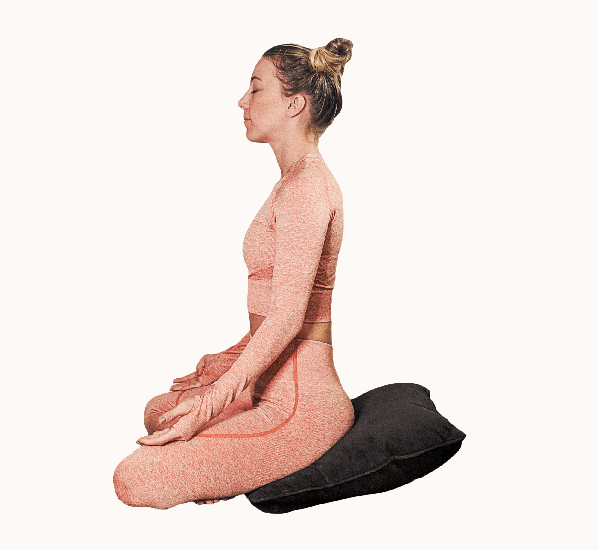 SEATED ON A PILLOW. Sit cross-legged and make sure your hips are elevated on a pillow - ideally allowing your hips to be slightly higher than your knees.