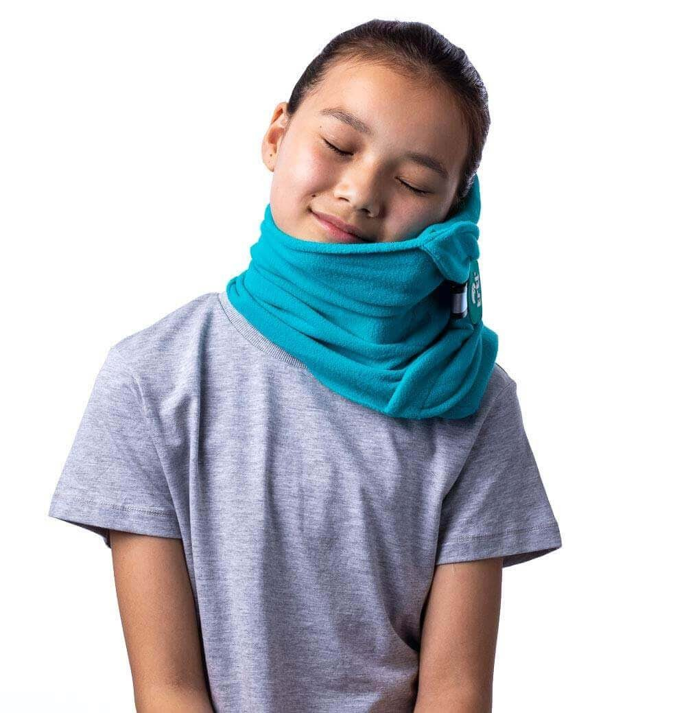 A young girl sleeping with a trt neck blanket.