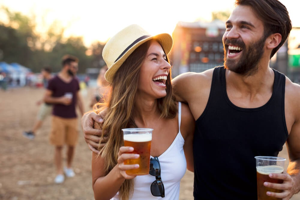 couple laughing with beer