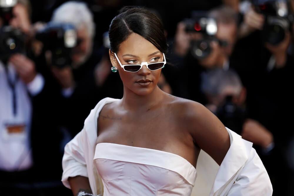 Rhianna wearing tiny white sunglasses