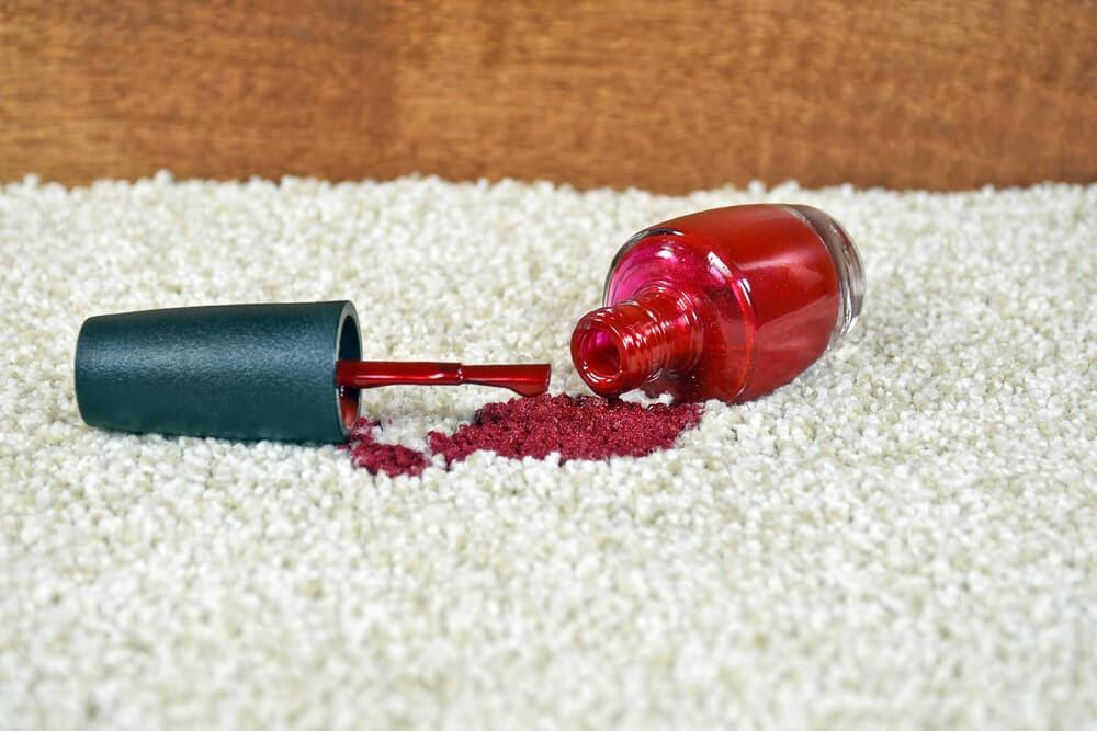 red nail polish on light carpet