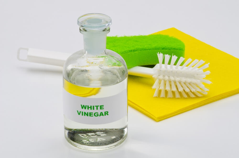 vinegar and cleaning brush