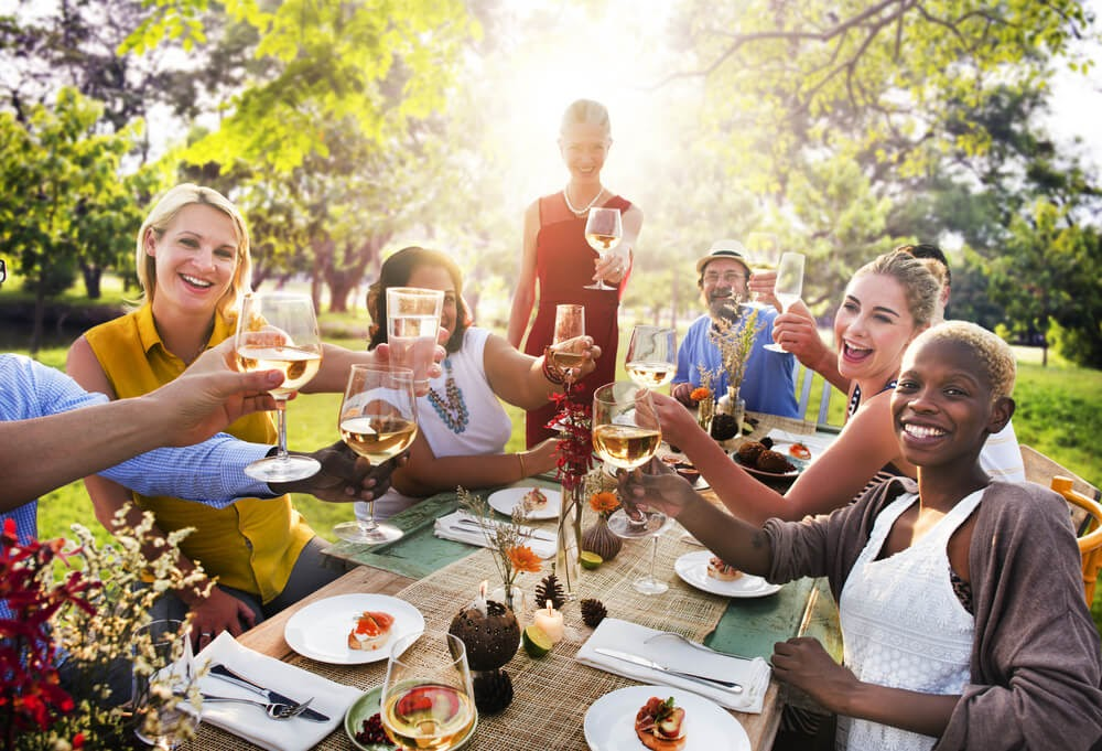 group of friends cheersing at a dinner party