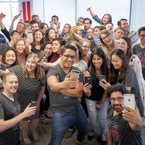 Group photo of Social Driver staff smiling, laughing and taking selfies.