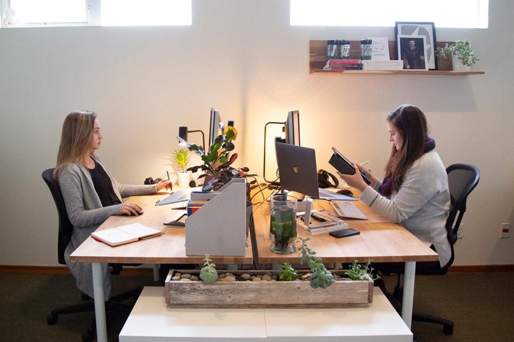Two members of the Bellingham team at their desks