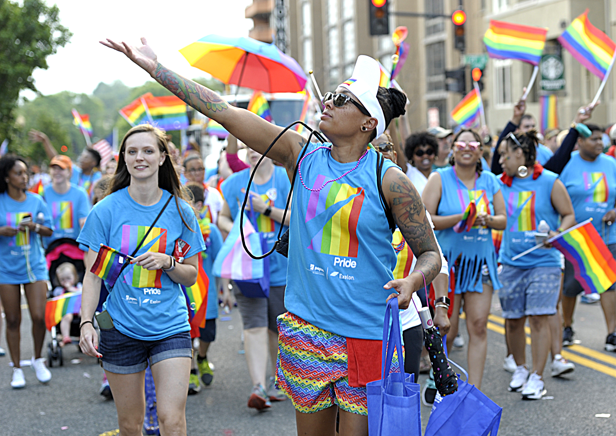 Pride March with flags and Pepco sponsored t-shirts