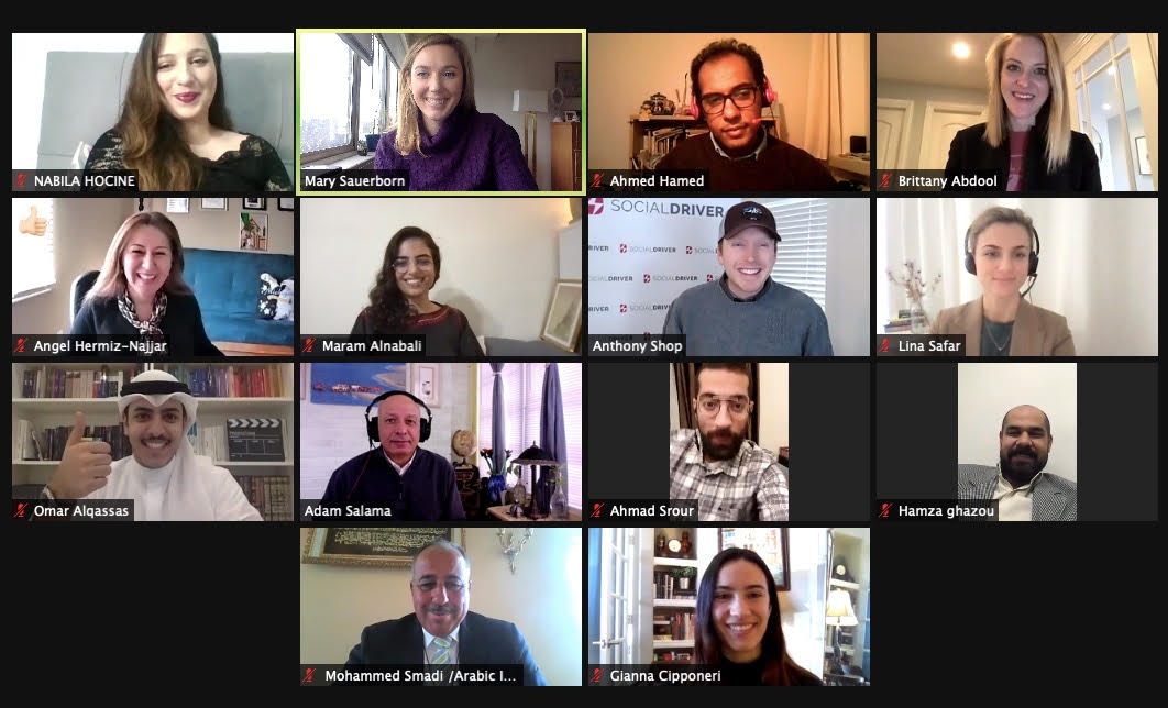 Screenshot of zoom call with a dozen people smiling