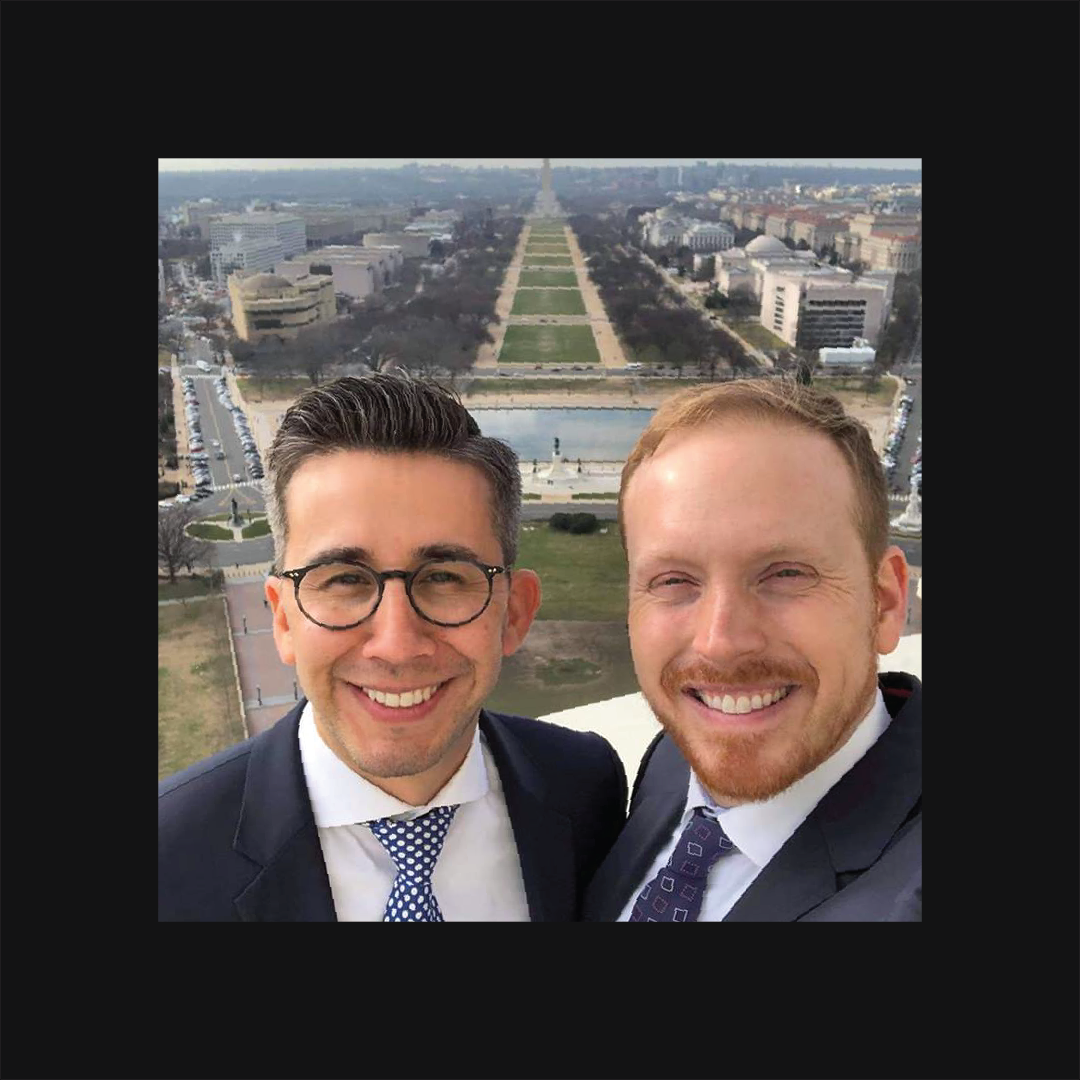 Social Driver Co-founders Thomas Sanchez and Anthony Shop taking a selfie on a rooftop overlooking the Washington Monument.