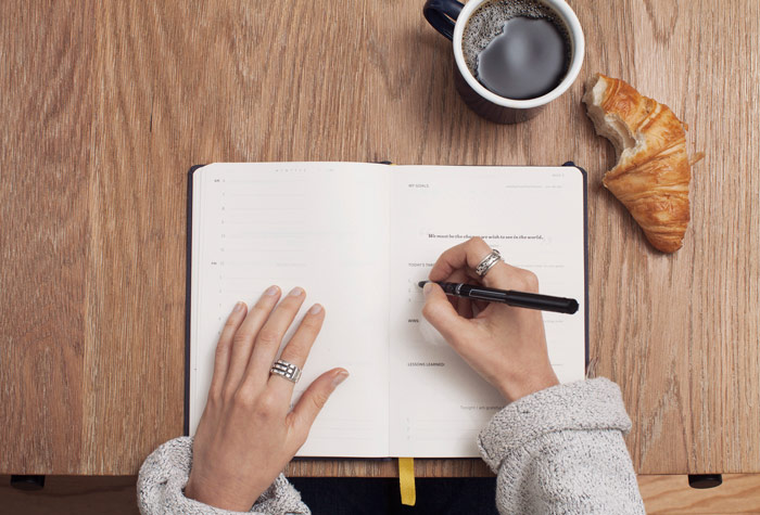 College student planning life lessons over coffee and croissant