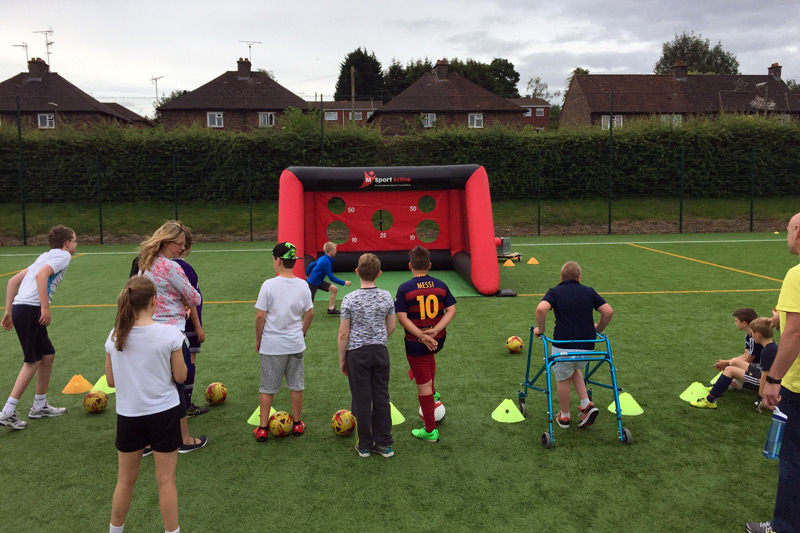children waiting to try speed goal