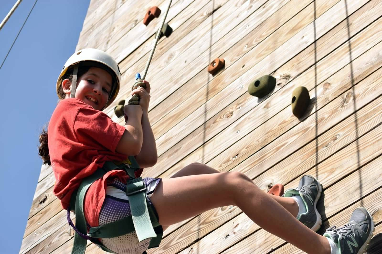 Kid climbing a rock wall