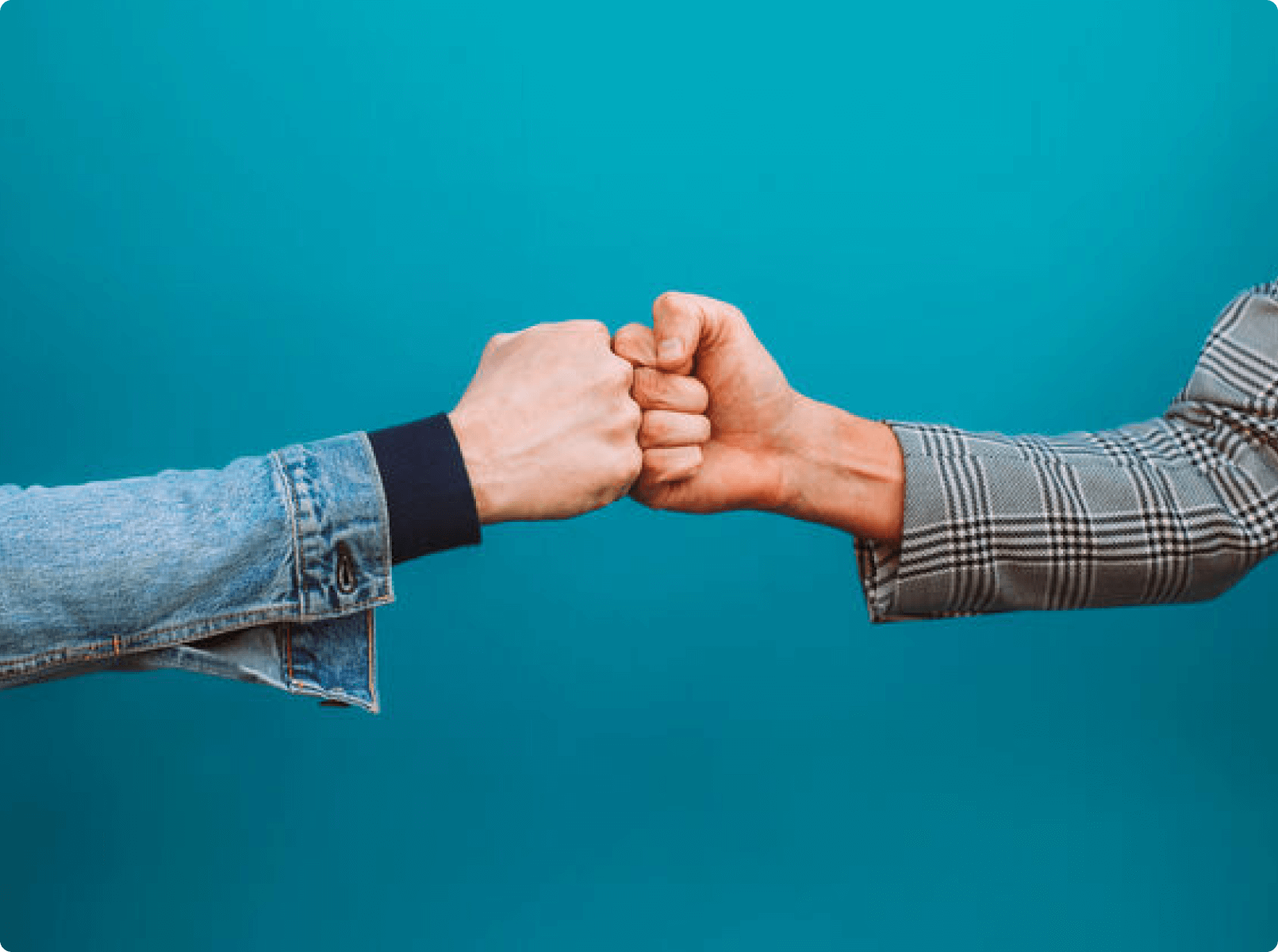 photo of two hands bumping fists