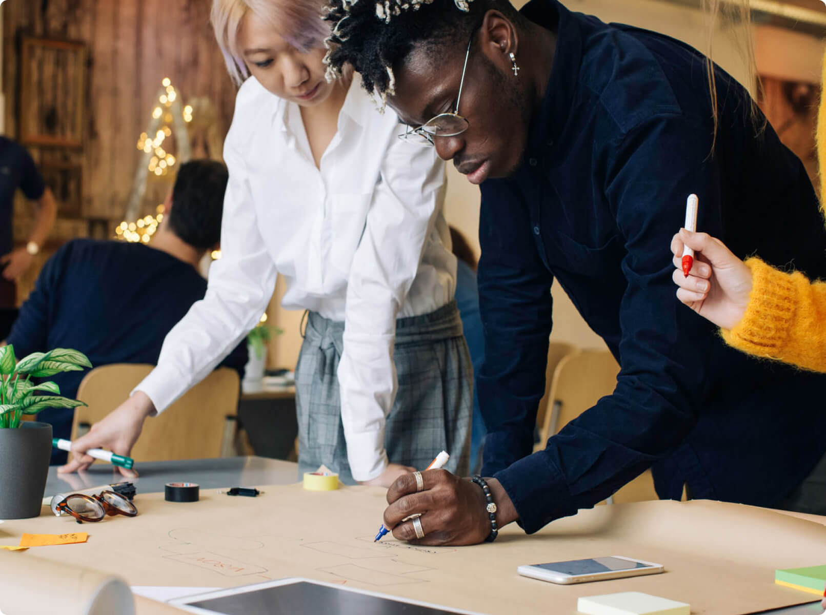 photo of a man and woman working at a table