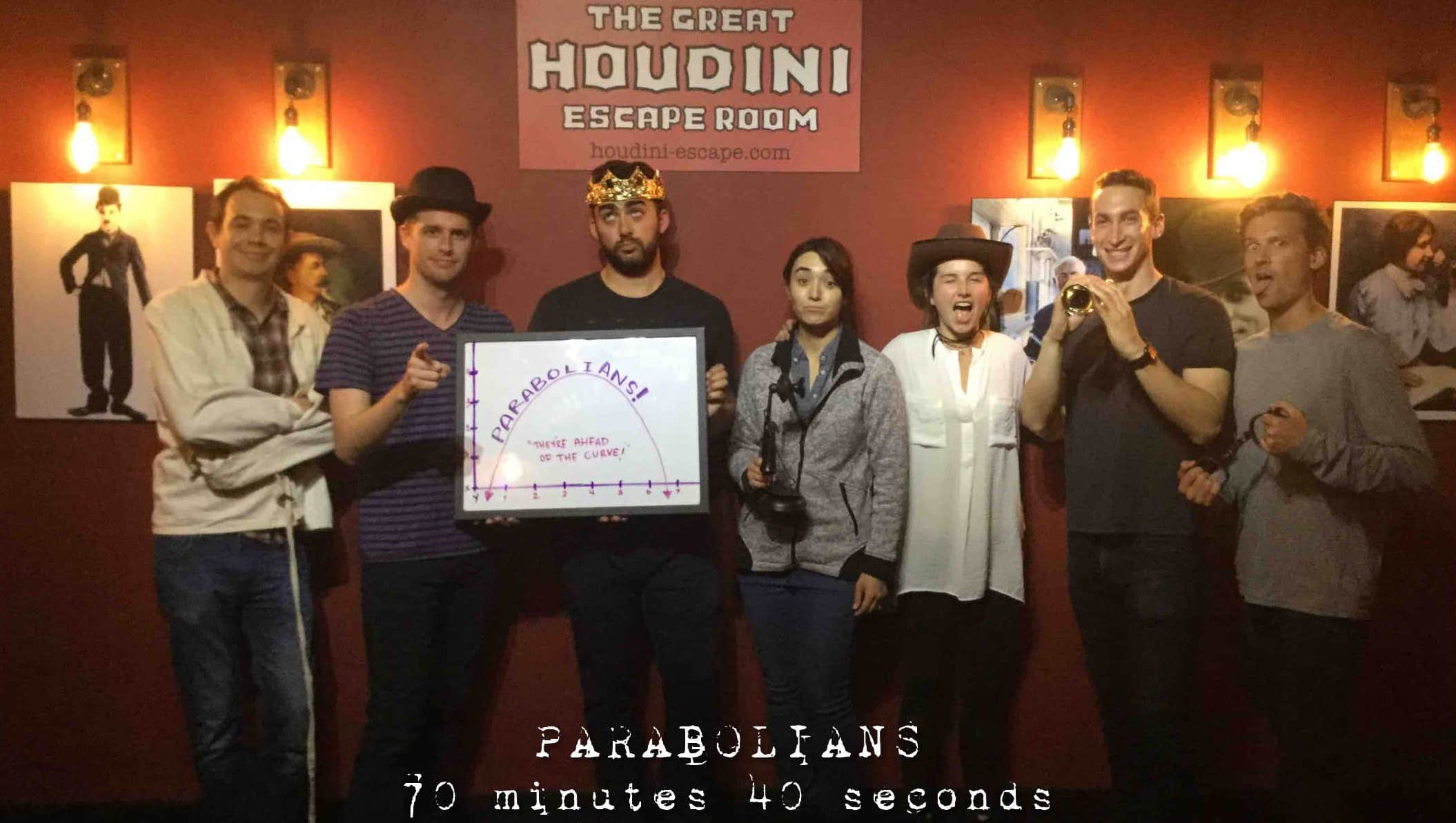 Parabola employees celebrate Escape Room completion.
