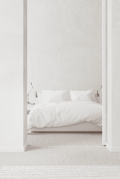 An entrance to a white bedroom