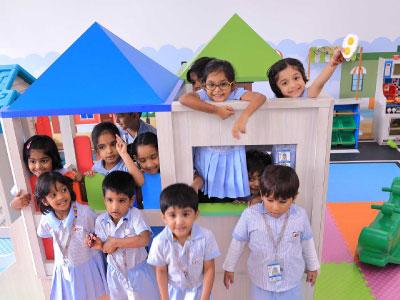 Kindergarten Children Playing in Play area at GIIS Dubai School