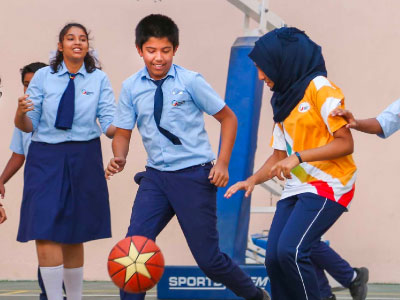GIIS Secondary School Students Playing football inside GIIS Dubai Campus