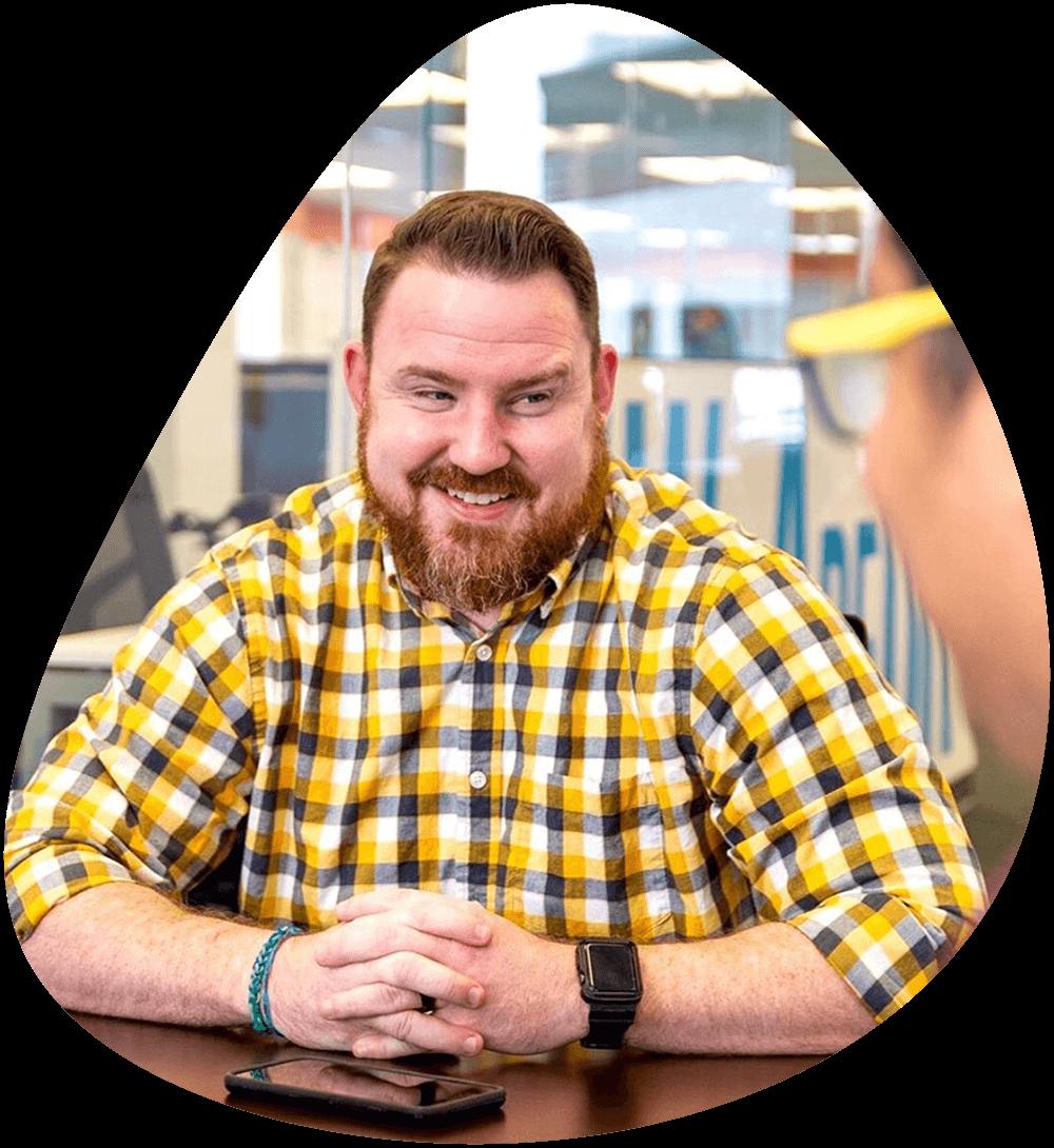 Digital Resource team member smiling during a team meeting