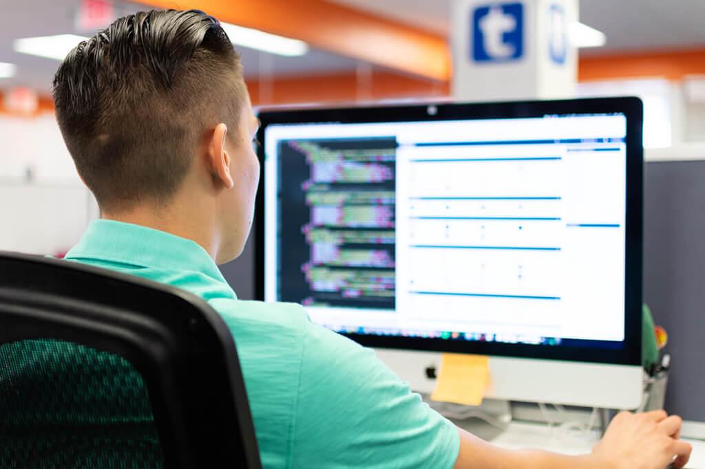 Web developer working on a marketing client's website