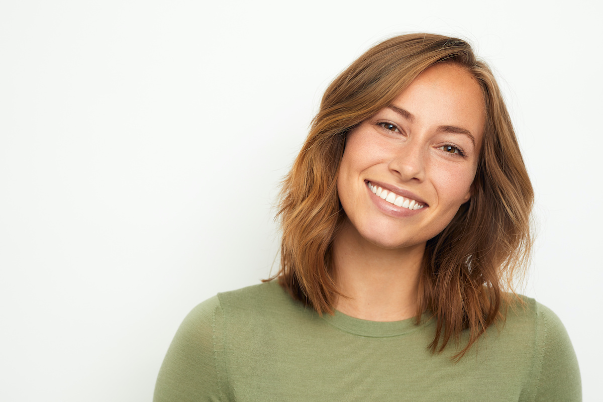 woman looking to side smiling