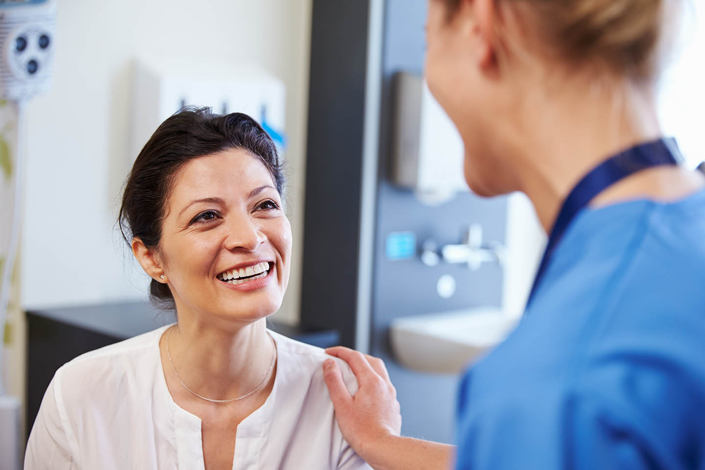 dental hygienist talking and laughing with a patient