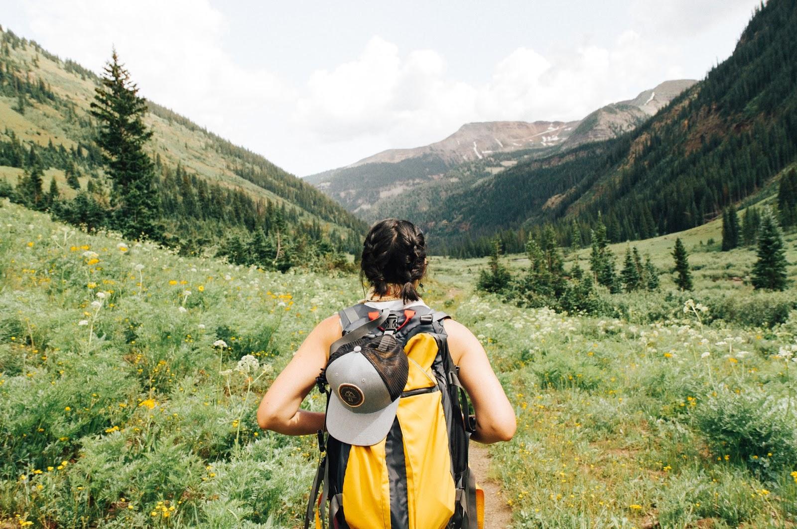 female hiking through trail