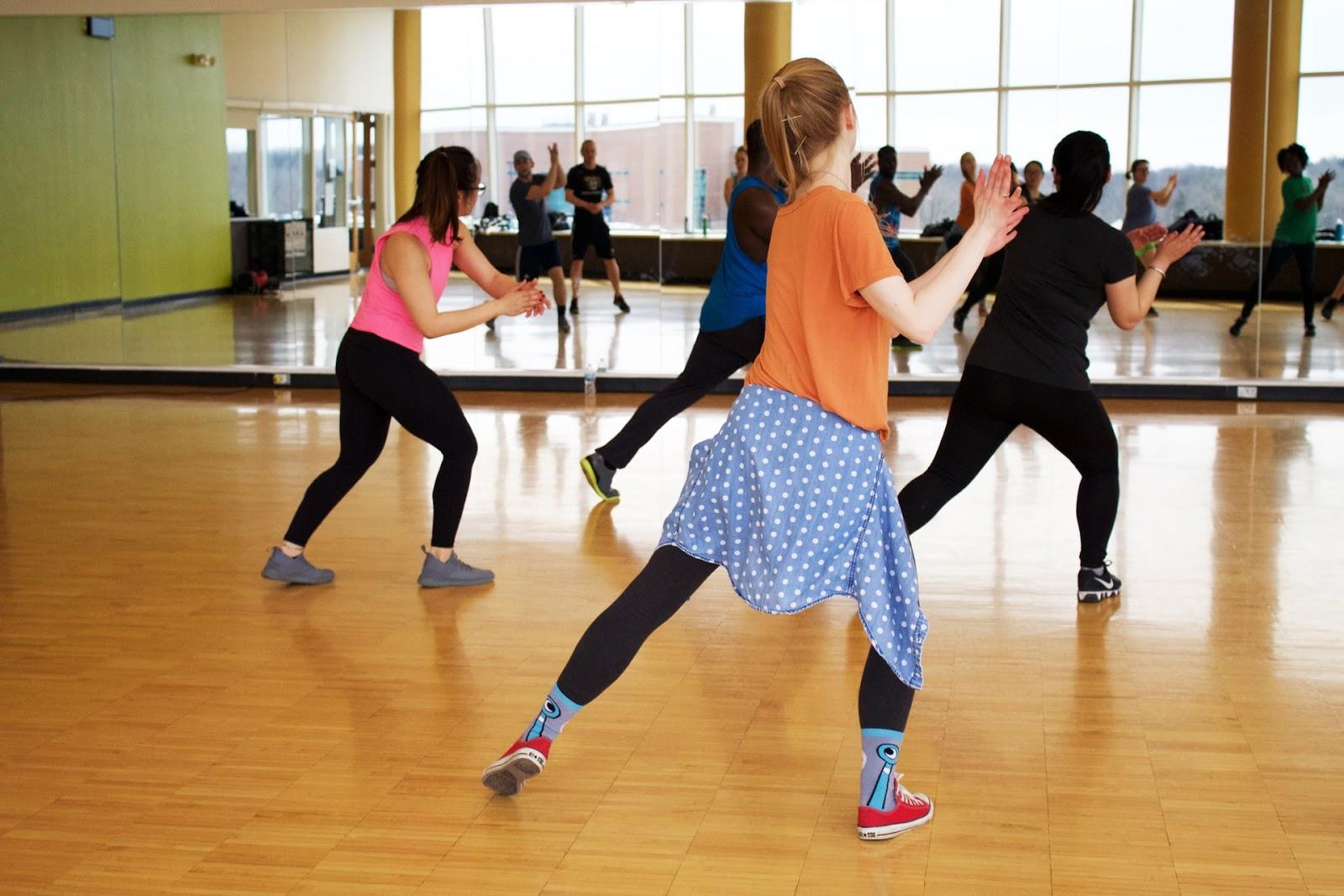 group of people dancing in a studio