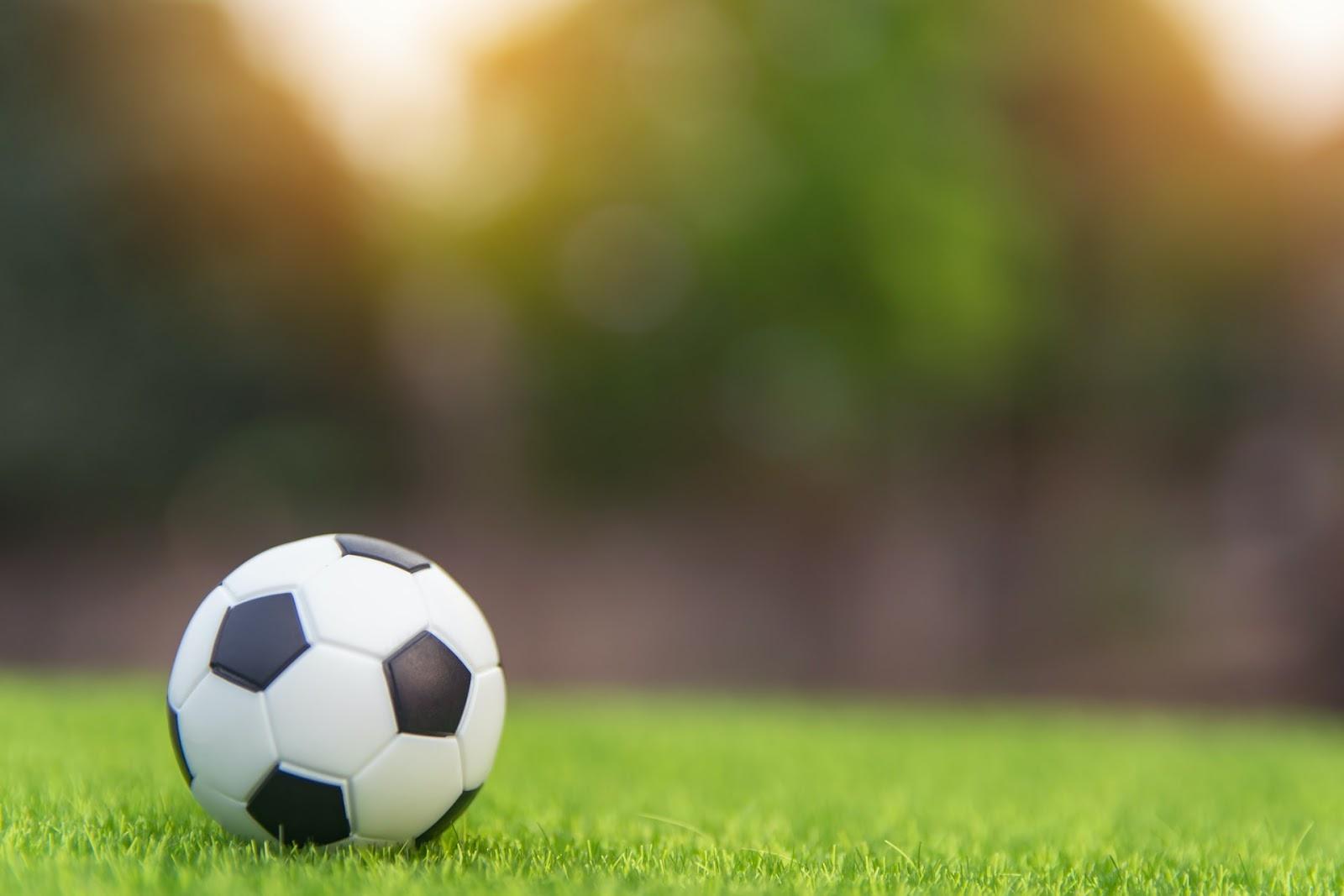 soccer ball on field of grass