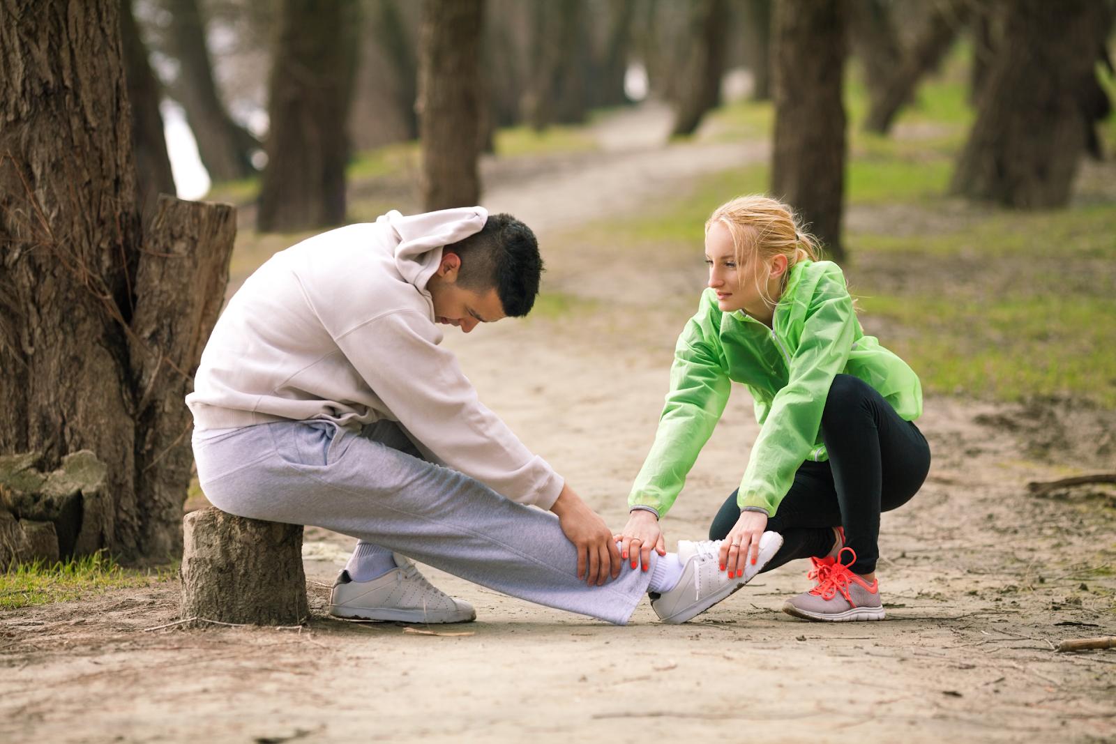 woman helping injured teammate
