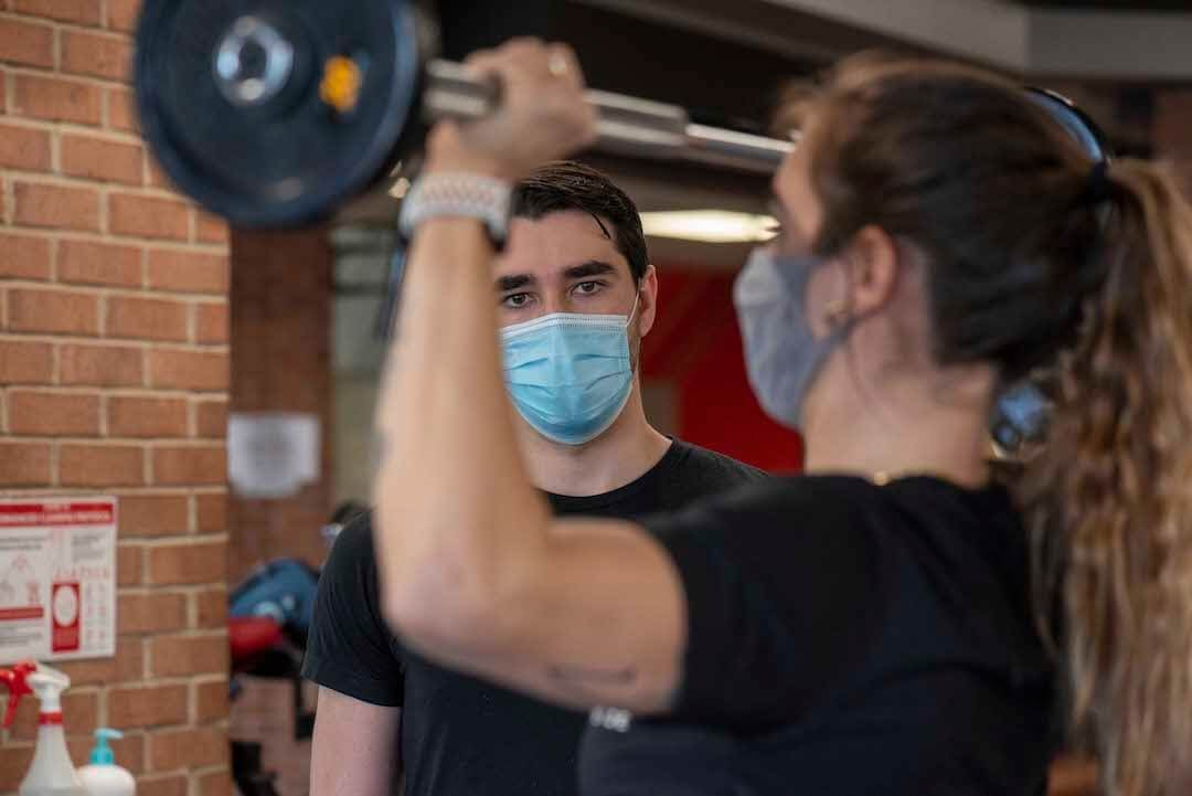 gym personal training wearing masks barbell