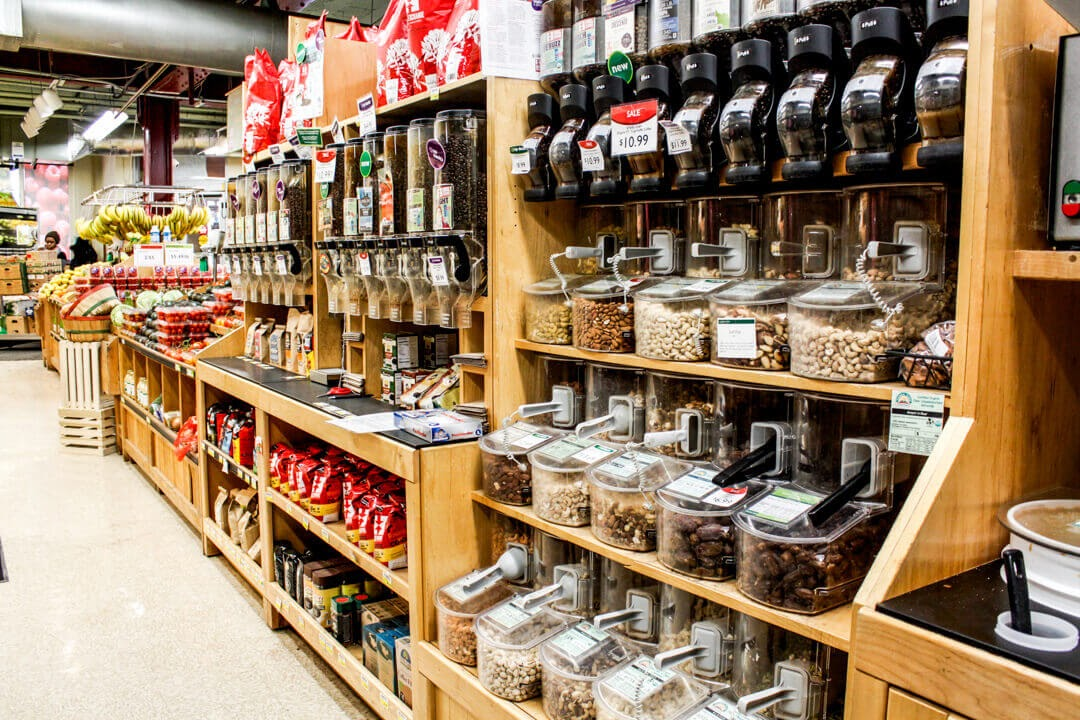 bulk goods nuts berries grocery store coop sustainable products shopping wooden displays