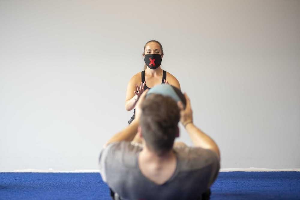 personal training medicine ball mask floor work gym