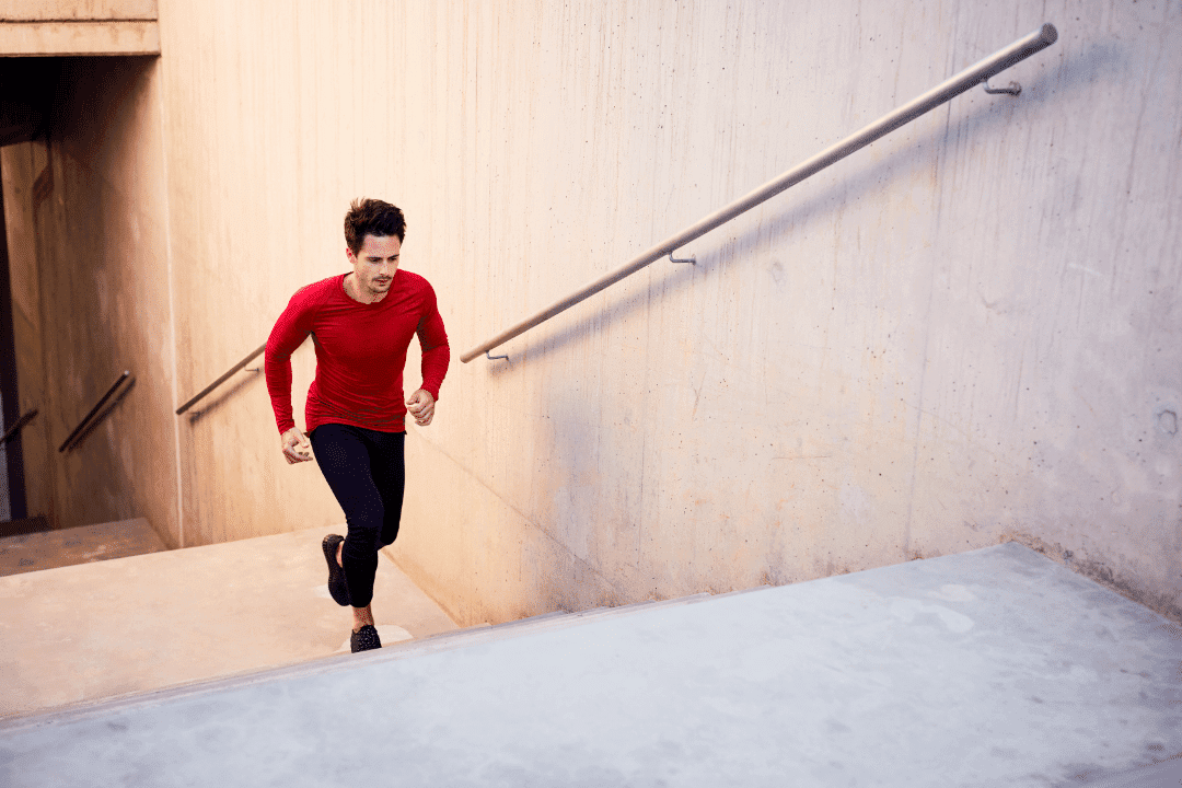 young man running up stairs outdoor exercise red shirt