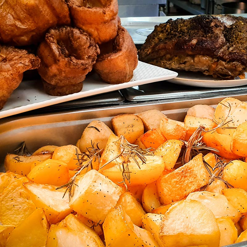 Sunday Lunch in buffet style. Home made Yorkshire pudding, rosted potatoes with rosemary seasoning and roasted meat.