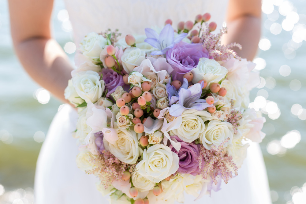 Wedding bouquet of beautiful flowers in brides hands