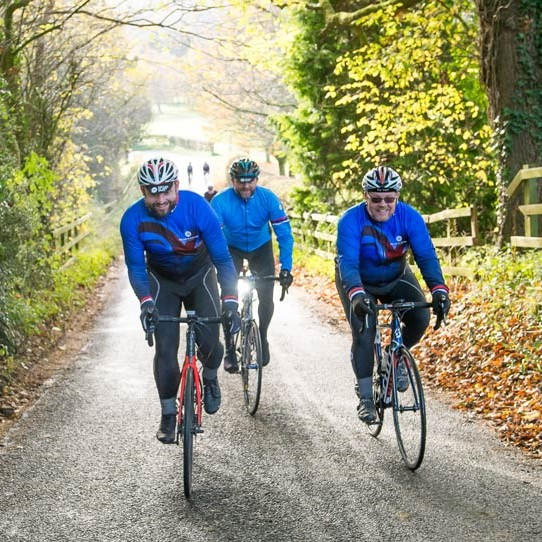 cycling group riding in the New Forest in Dorset