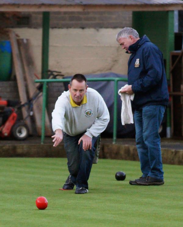 Man throwing bowling ball