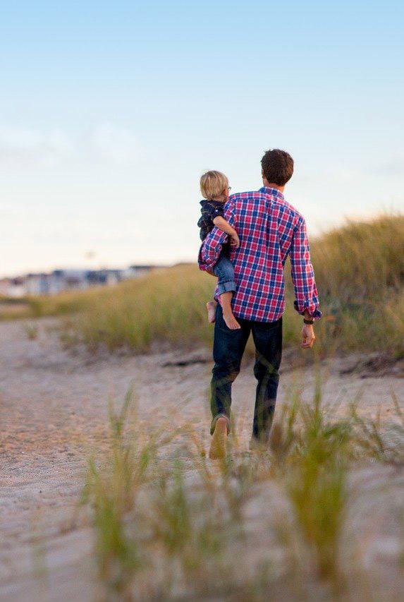 Dad on beach holding child