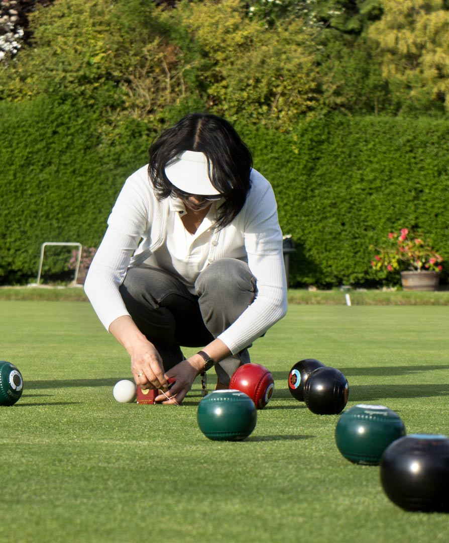 Lady getting reading to play bowls