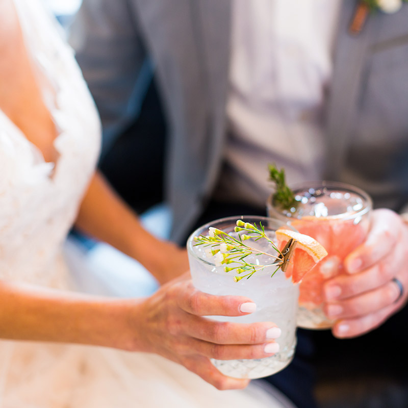Wedding couple toasting glasses of coktails at wedding breakfast reception in Bournemouth